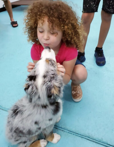 Little-girl-and-puppy-Advanced-Canine-Development